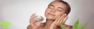 Woman Applying CBD Face Cream